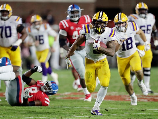 LSU running back Derrius Guice (5) runs on a long gain against Mississippi during the second half of an NCAA college football game in Oxford, Miss., Saturday, Oct. 21, 2017. No. 24 LSU won 40-24. (AP Photo/Rogelio V. Solis)