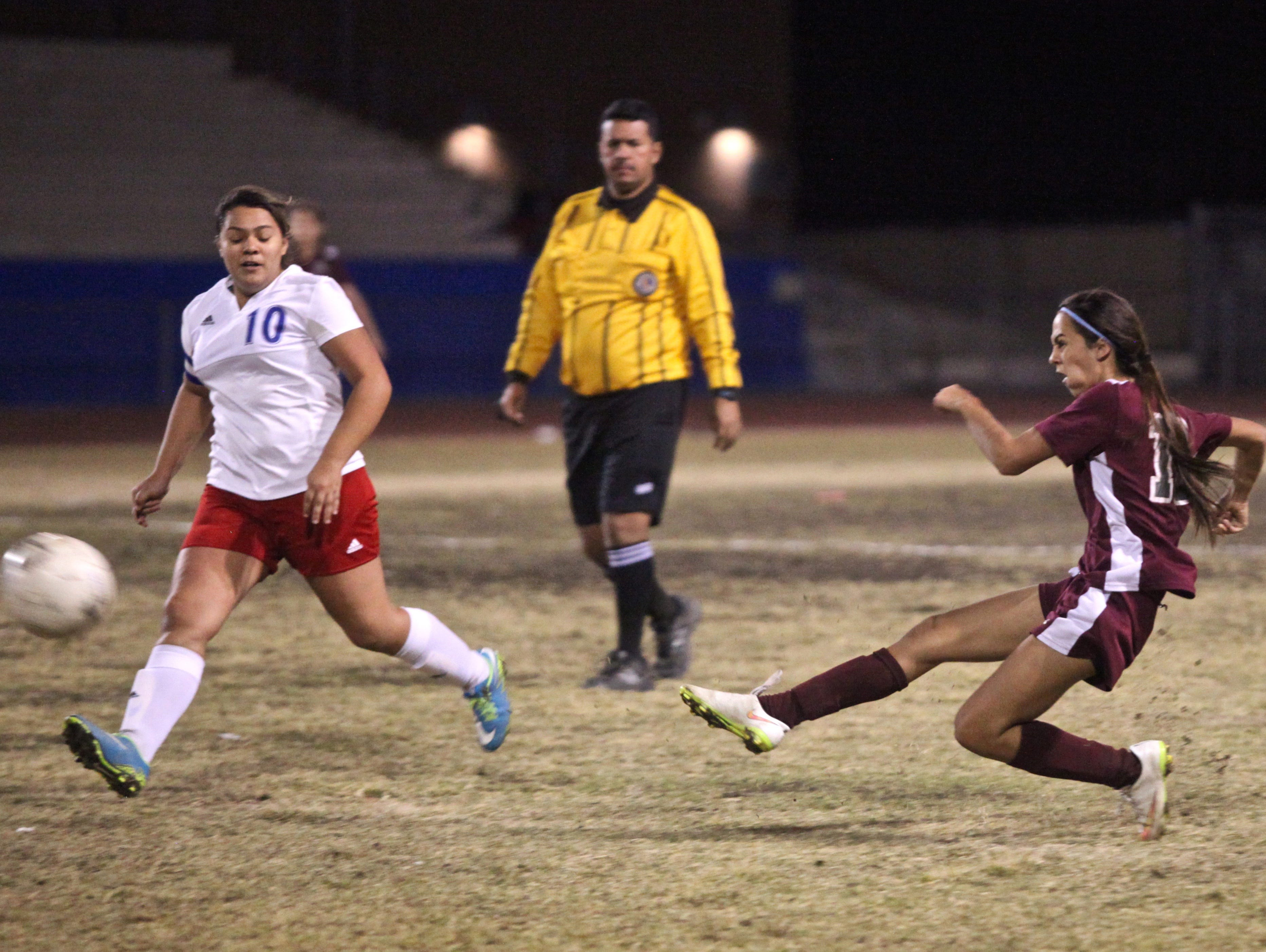 Rattlers' Fernanda Mercado (19) attempts a long shot during an away match with the Rajahs on Tuesday.
