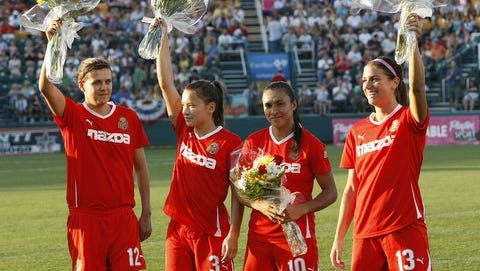 Alex Morgan, far right, was a rookie on the 2011 Flash team that won the WPS Championship. She's pictured here with former WNY teammates, from left, Christine Sinclair, Ali Riley and Marta.