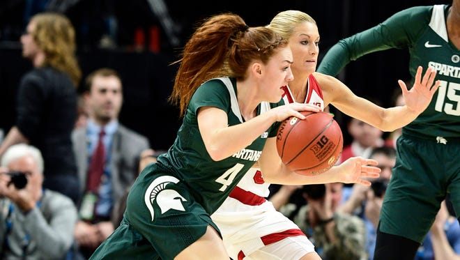 Mar 1, 2018; Indianapolis, IN, USA; Michigan State Spartans guard Taryn McCutcheon (4) attempts to get past Indiana Hoosiers guard Tyra Buss (3) in the first half during the second round of the Big Ten Conference Tournament at Bankers Life Fieldhouse.