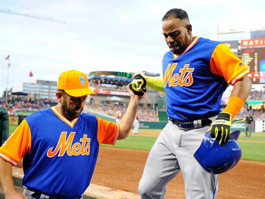 Yoenis Céspedes, right, was helped off the field after he suffered a hamstring injury while rounding the bases in Washington in Aug. 25.