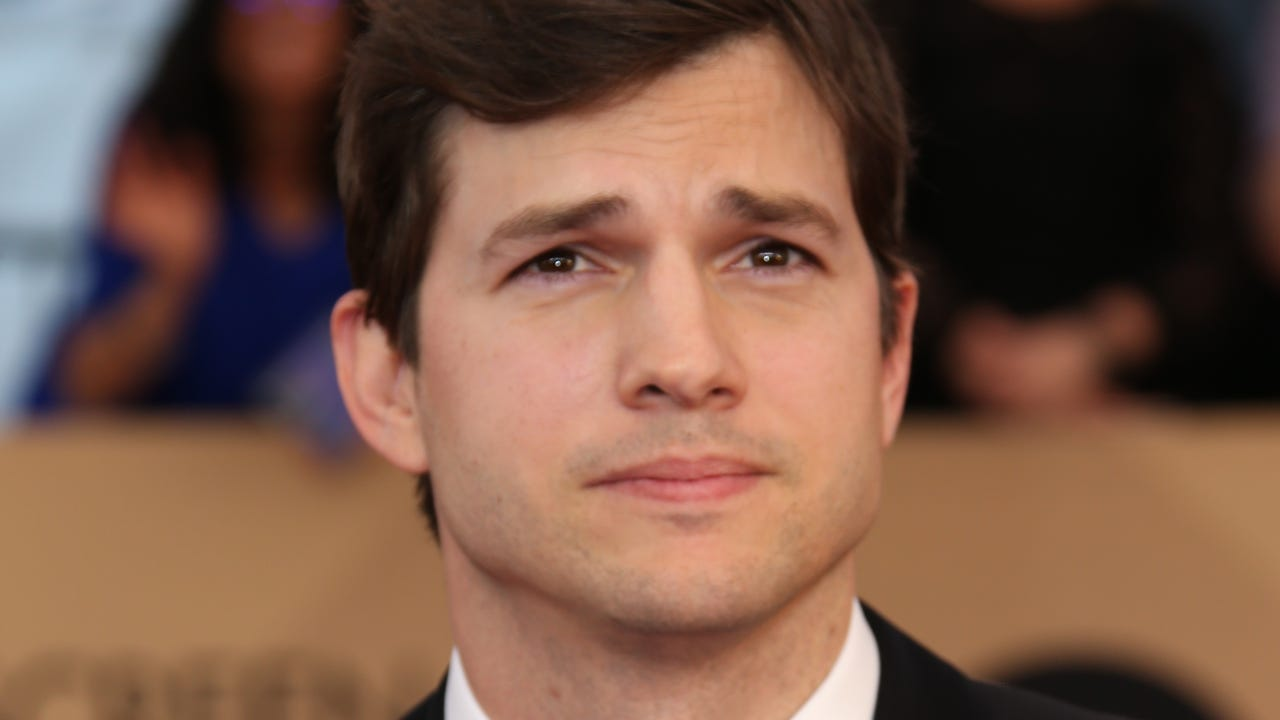 Ashton Kutcher isn't the type to drown his breakup sorrows with a carton of ice cream and a box of tissues.