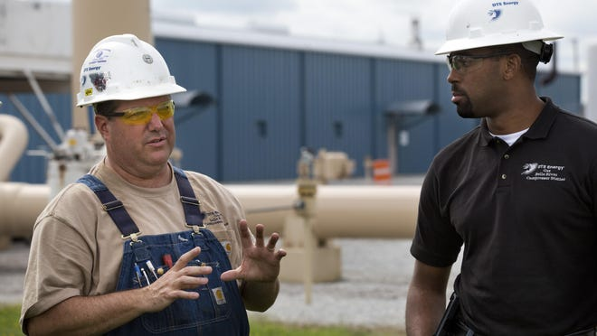 Jeff Cottrell, senior repair employee, stands next to Siraj Mumin, site supervisor, during a tour with his parents Fred and Maraleen Cottrell Thursday, September Wednesday, September 9, 2015 at the DTE Belle River Mills Compressor Station in China Township. The station is celebrating its 50th anniversary Saturday, September 19.