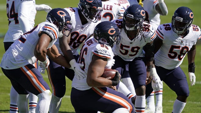 Chicago Bears defensive end Akiem Hicks (96) is congratulated by teammates following a turnover during the second half of an NFL football game against the Carolina Panthers in Charlotte, N.C., Sunday, Oct. 18, 2020.
