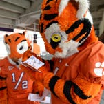 The Clemson Tiger and Tiger Cub sign autographs during Fan Day Sunday, August 17, 2014 at Clemson's Memorial Stadium.