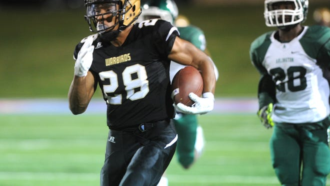 Abilene High's Abram Smith (28) runs away from the Arlington High defense during the Eagles' 65-36 bi-district win last Friday at Shotwell Stadium.