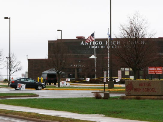 Yellow tape surrounds the parking lot outside Antigo