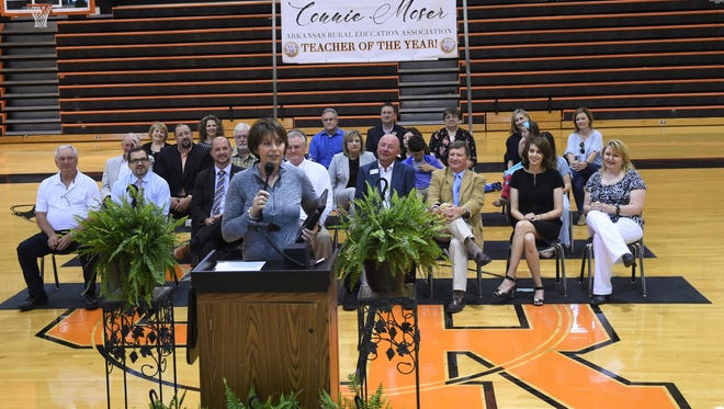 Connie Moser, the Arkansas Rural Education Association's Teacher of the Year, addresses Calico Rock students, faculty and staff after being surprised with her award at an assembly Friday.