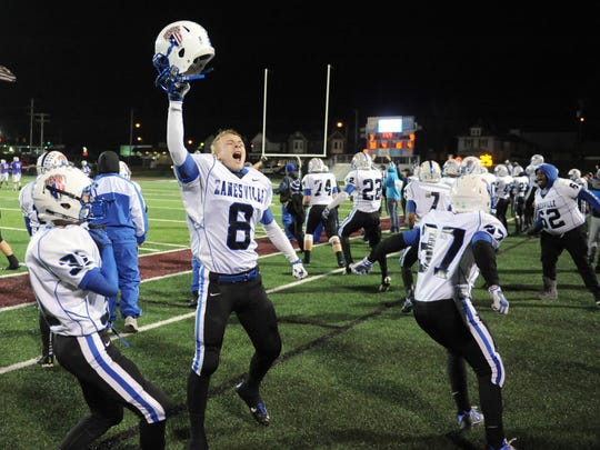 Zanesville's Andrew Everson celebrates with the rest of the Blue Devils in the waning seconds of a 9-3 win over Columbus DeSales in a Division III regional semifinals game in Newark. It was one of three playoff wins for the Blue Devils in 2015.
