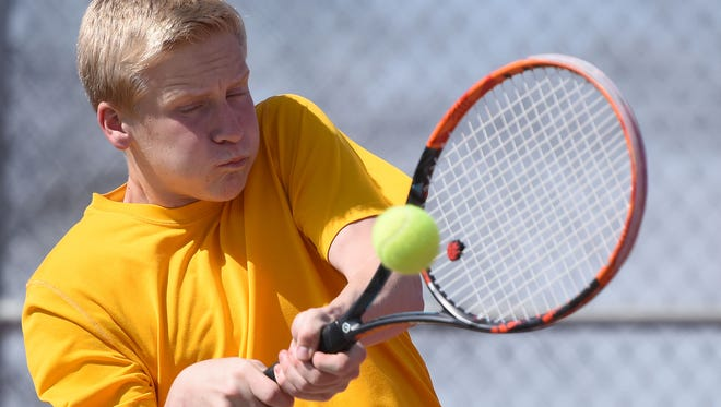 Roosevelt's Spenser Smith returns the ball to  Lincoln's Kaleb Dobbs during the Madison Triangular at Kuehn Park Tennis Courts on Tuesday.