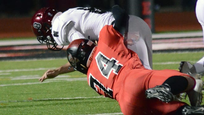 Jacob Price (74) and the Pinckney defense hope to slow Walled Lake Western's monster offense on Friday night.