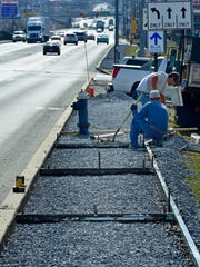 Crews from R.A. Hill, Chambersburg, install a sidewalk