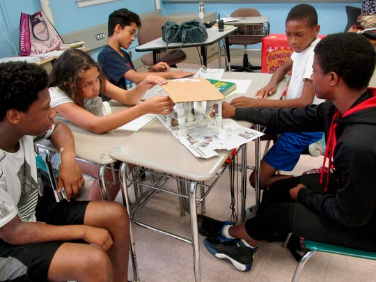 Soehl Middle School students Tyson Knight, Isabella Almeida, Arnold Saenz, Sincere Taylor and Jahson Correa working on a design challenge at the 21st Century Summer STEM Academy on July 17.