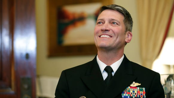 U.S. Navy Rear Admiral Ronny Jackson, M.D., sits with