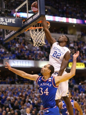 Kentucky Wildcats forward Alex Poythress  pins a shot by Kansas forward Perry Ellis to the backboard in the first half. Kentucky and Kansas squared off in game two of a college basketball doubleheader at Bankers Life Fieldhouse Tuesday, November 18, 2014.