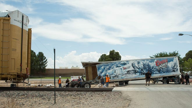 A BNSF train collided with a tractor trailer, spilling beer kegs on the side of the train tracks on the 6000 block of south Main Street, near the Admiral Beverage Corporation facility in Mesilla Park, Friday, June 2, 2017.