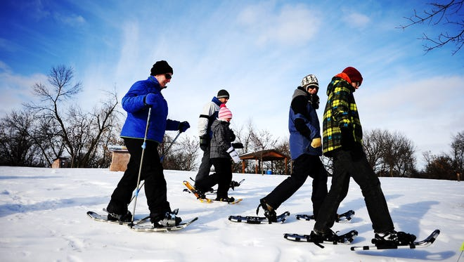 (From left) Mary Enright, Mike Streyle, Kadence Streyle, Jessica Simmons and Emmett Simmons participate in a guided snowshoe tour for beginners through the Mary Jo Wegner Arboretum as part of the Frosty Frolics Weekend in 2014.