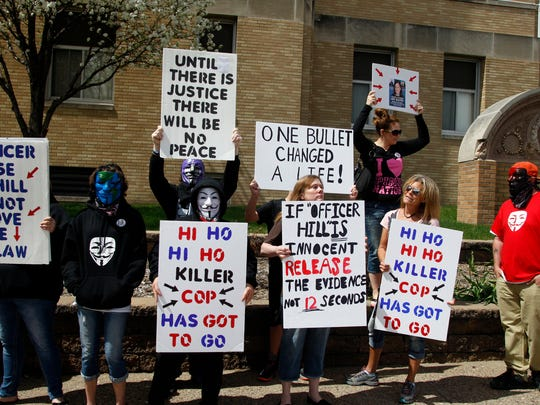 Protesters rally on April 13 in front of the Des Moines County Courthouse in Burlington. The crowd was calling for the resignation of Burlington police officer Jesse Hill, who shot and killed a woman while firing his gun at her family's dog.