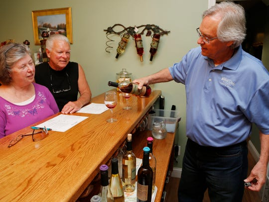Co-owner Rick Black pours Chambourcin for Mike and Deb Miller of Kokomo to sample Friday, May 8, 2015, at Wildcat Creek Winery, 3233 East 200 North in Lafayette. The winery has produced approximately 1 million glasses of wine during its decade in business.