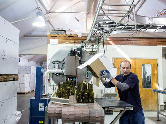 Royce Duckett, of the Biltmore Winery production crew, works on the bottling of the 30th anniversary special edition wine.