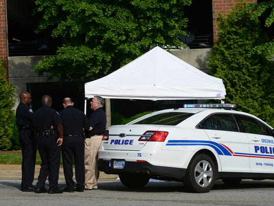 Greenville police department investigate a body found outside of Richardson Street parking garage on Thursday.