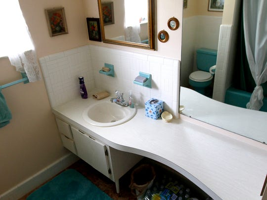 Original tile, cabinets, toilet and tub in a Michigan home in North Fort Myers.