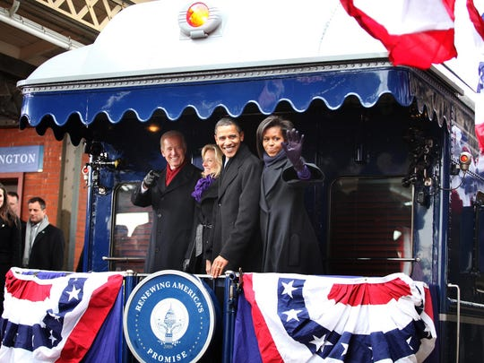 Then President-elect Barack Obama and Vice President-elect Joe Biden and their spouses wave to the crowd at the Wilmington train station in January 2009, on their whistle-stop tour from Philadelphia to Washington for the inauguration.