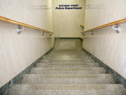 Stairs lead downstairs to the Stevens Point Police Department in the County-City Building, Tuesday, June 9.