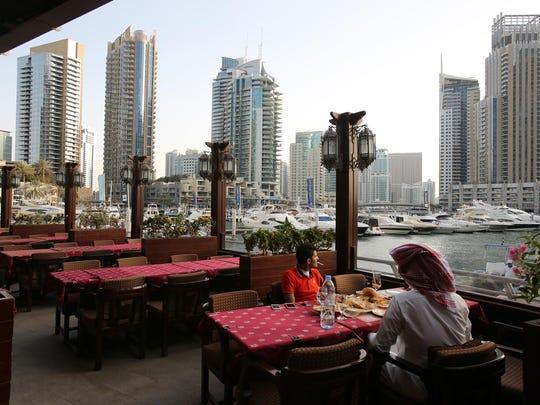 People dine at the Reem al-Bawadi restaurant at the Marina Waterfront.