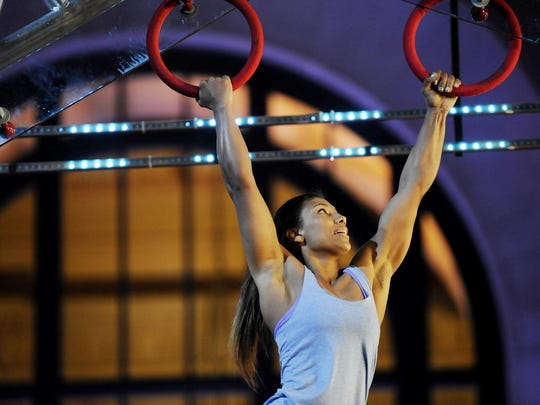 """Former Vanderbilt pole vaulter Meagan Martin competed in the Ninja Warrior qualifier in Kansas City, becoming the first woman to complete this year's course. This is the second time on the show for Martin, now a professional rock climber living in Boulder, Colo., and she is one of several competitors with local ties on this year's show. Credit: Fernando Leon/NBC AMERICAN NINJA WARRIOR -- """"Kansas City"""" -- Pictured: Meagan Martin -- (Photo by: Fernando Leon/NBC)"""