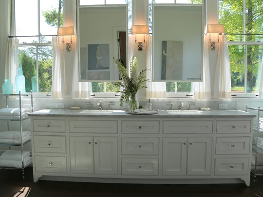 Sinks were placed in front of windows in the master bath, maximizing natural light.