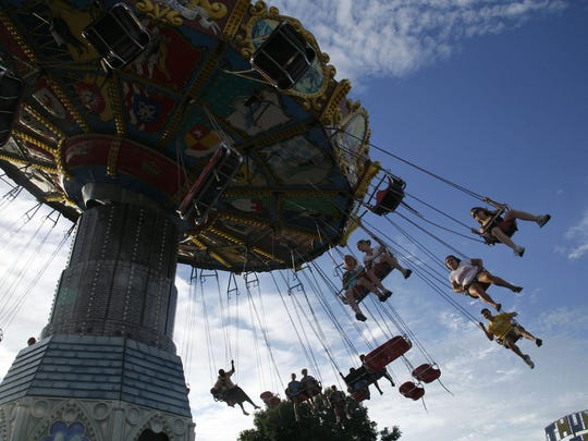 The Dream Machine spun riders high over the Iowa State Fair midway one evening in 2008.