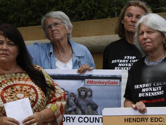 Animal activists protest Hendry County monkey farms recently outside Harborside Event Center in Fort Myers.