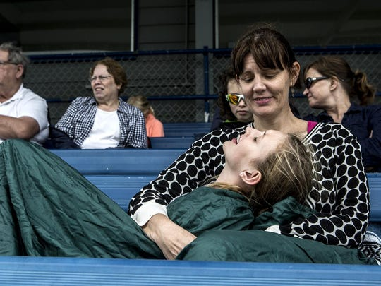 A cancer diagnosis does not change the fact that life continues. On an unusually chilly day in June, Stacey Heath and her daughter, Anna Kate, cuddle up to watch her son, Noah, play in the Babe Ruth baseball championships.