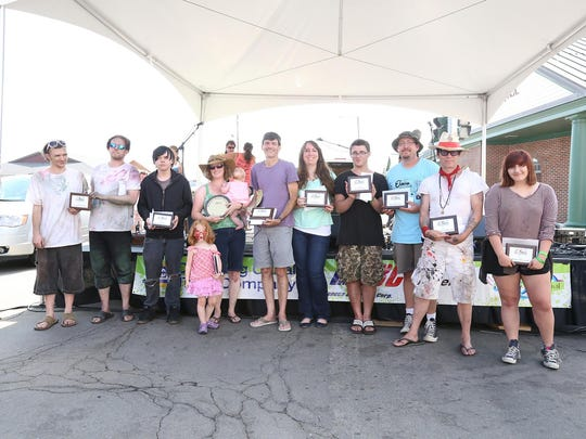Twelve awards were given to the 2015 Elmira Street Painting Festival artists. Winners include Crystal Parks, ESPF first place; David Bishop, ESPF second place; Tara Maxwell, ESPF third place; Katelyn Armstrong, People's Choice; Mike Houghton, ESPF honorable mention; Ben Erway, ESPF most original; Matt Dunn, youth award; Noah Lubberts, honorable mention; Jason Flint and Chris Zimmerman, ESPF first place team; Mariano Casciotti, Chalk It Up first place; Katie Hardiman, CIU second place; and Sam Abbey, CIU third place.