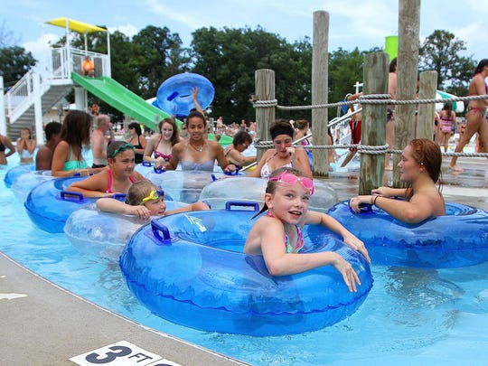 Crowds packed the Lincoln Park Aquatic Center on a perfect summer day on Monday. The city owned and operated pool enjoyed a high attendance weekend after a rainy June and early July kept families away during the center's fourth season.