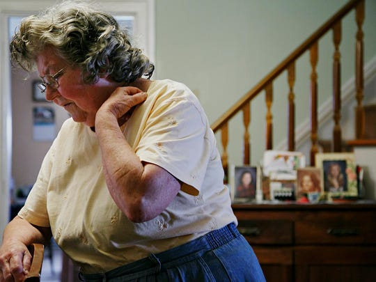 JoAnn Benning stands in her Clarksville home June 23. Her daughter Julia disappeared after Thanksgiving in 1975, and JoAnn says she still hates the holiday.