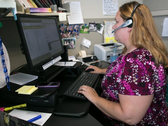 Dessie Holliday of Irondequoit works at Pittsford Federal Credit Union in Mendon on Thursday, July 23, 2015.