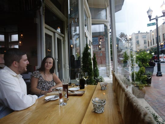 Mike Discavage and Cynthia Black, both of North Wilmington, dine at La Fia in downtown Wilmington July 23, 2014.
