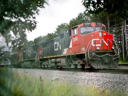 A train sits on the railroad tracks near Woodward Drive in Stevens Point on July 14, 2015.