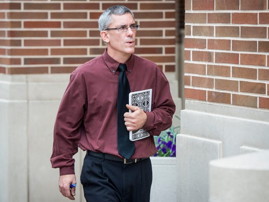 Former Dover Area music teacher Matthew Puterbaugh walks to the York County Judicial Center for back-to-back arraignments for charges of alleged child molestation and possession of child pornography in this file photo.