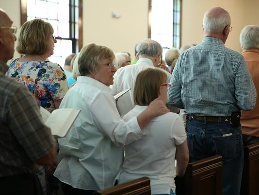4 Vicky and Caryn Kendrick joined in the dedication service for Trinity UMC Sat.