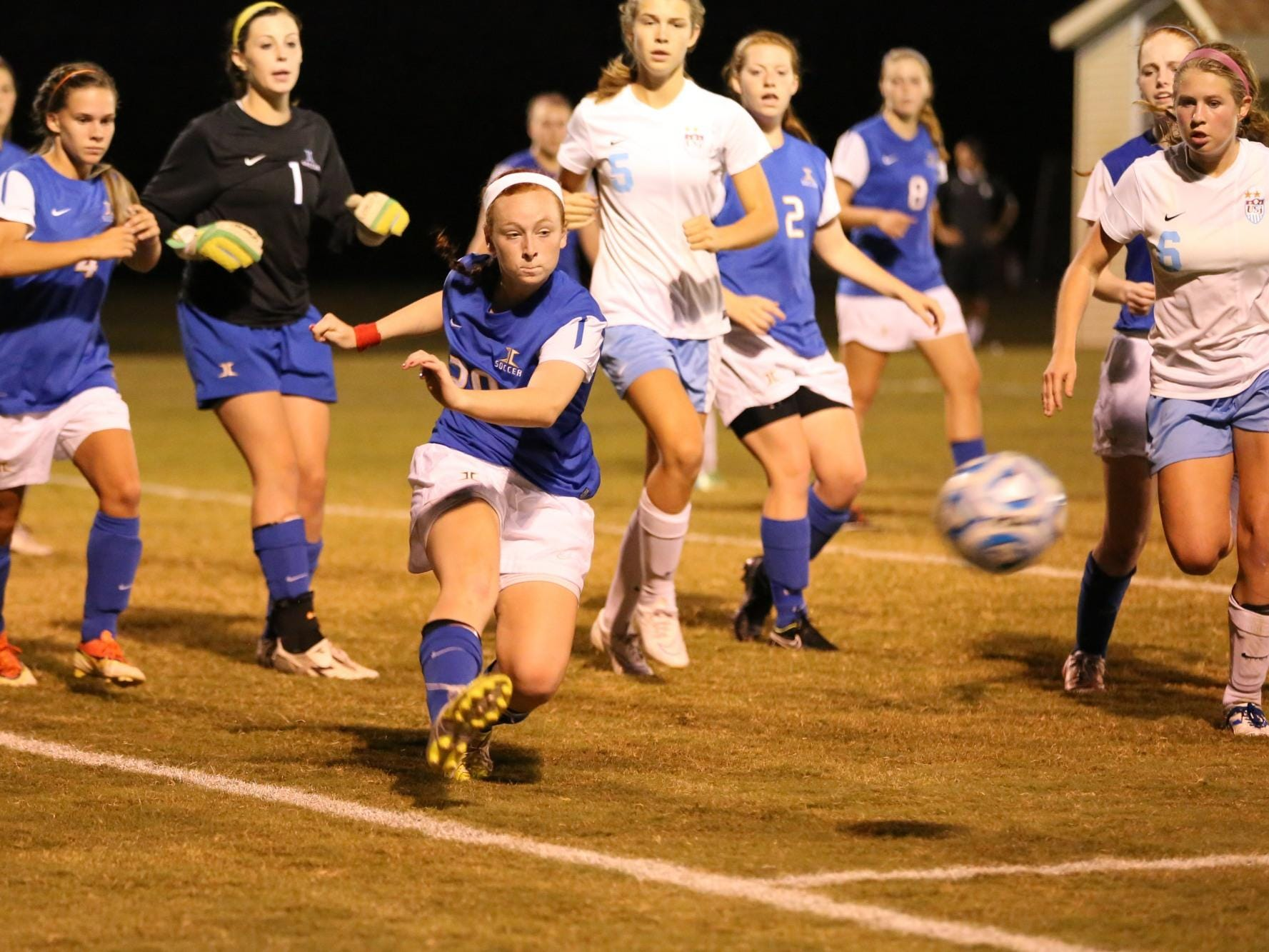 Jackson Christian's Catie Beth Hatch clears the ball against University School of Jackson last season.