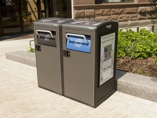 The garbage and recycling containers are solar powered.
