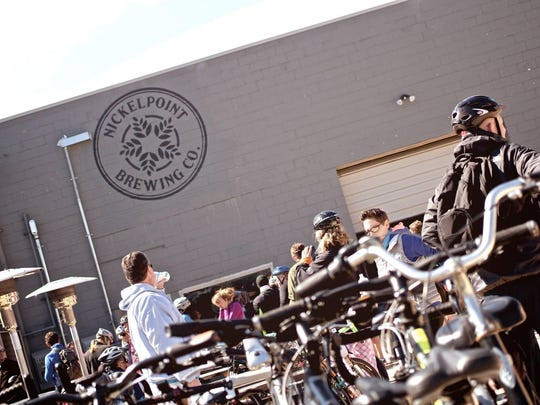 Participants stop at Nickelpoint Brewing during the 2015 Tour de Brew in Raleigh, benefitting non-profit organization Water for Good.