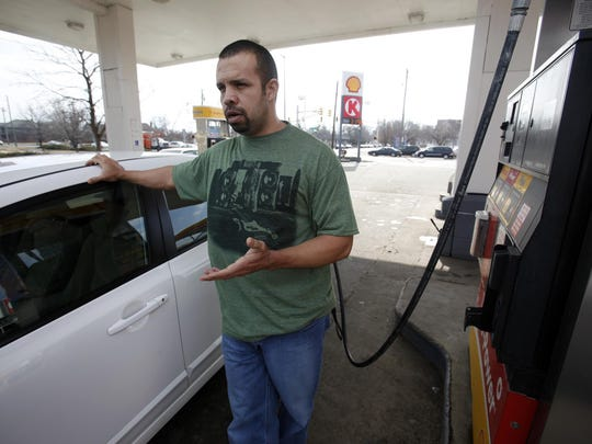 Ken Leslie, of Indianapolis, filling his tank in February 2011, had downsized from a Ford F150 to a Honda Civic to save money on the rising cost of gas. More fuel-efficient cars have reduced the amount of taxes paid for the miles traveled. In addition, the number of miles driven by Hoosiers has declined in recent years.
