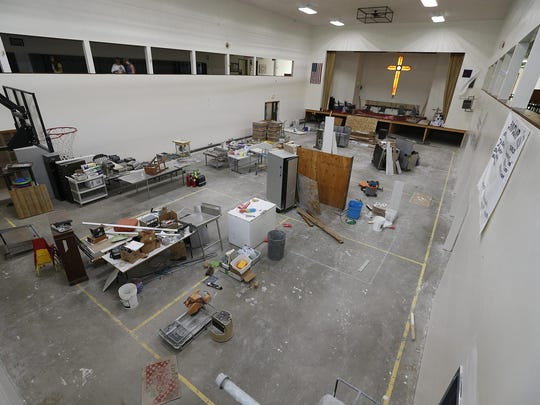 North Spencer Christian Academy's gymnasium is being used as a catch-all while rooms are being put back together following a June 14 flood.