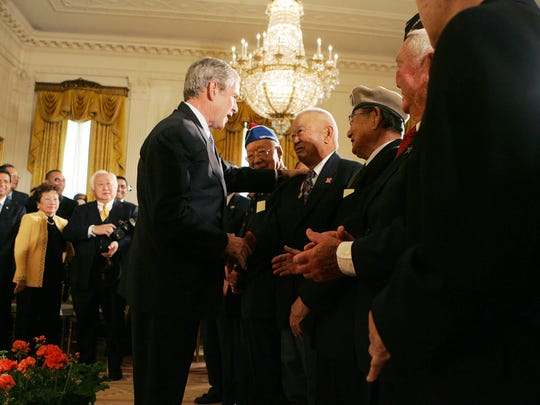 President George W. Bush takes a moment with Ben Kuroki in 2008, at the Celebration of Asian Pacific American Heritage Month in the White House. Kuroki flew nearly 60 combat missions in Europe and the Pacific.