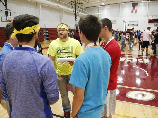 "Tyler McCoy talks strategy with a group of incoming students before they begin a whimsical competition that is part of freshman orientation at Calumet College of St. Joseph. ""(CCSJ is) a perfect mix for someone like Tyler who wants to be involved, wants to take the opportunity to really prove himself as a young adult, wants to aspire to become an influential leader in whatever he does,"" athletic director Peter Haring said."