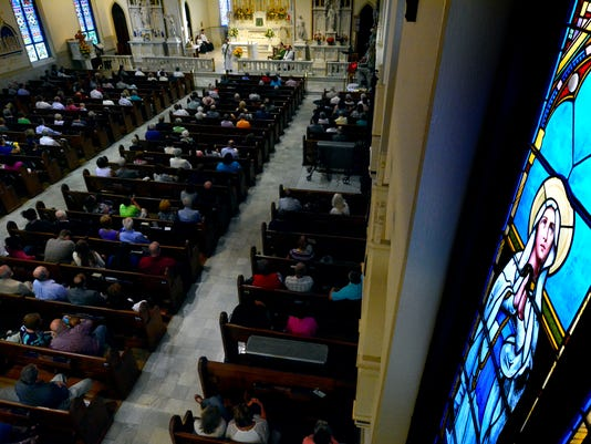 Catholics attend Mass at St. Mary's, 309 S. George Street, Sunday, September 20, 2015. Several St. Mary's members are attending Pope Francis' Mass in Philadelphia Sunday September 27. John A. Pavoncello - jpavoncello@yorkdispatch.com